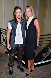 SEAN SAUNDERS and LADY VICTORIA HERVEY at the Art of Futebol - a charity auction of 11 footballs signed by 11 Brazilian legends from Pele to Neymar & decorated and designed by 11 leading contemporary artists in aid of Action for Brazil's Children Trust held at the Brazilian Embassy, 16 Cockspur Street, London on 10th July 2014.