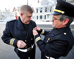 """EMS honor guard members put final touches on their uniforms. A funeral service and procession is held for longtime Bethlehem Emergency Medical Service employee William """"Billy"""" Guth Jr. on March 21, 2015, in Bethlehem. (Chris Post 