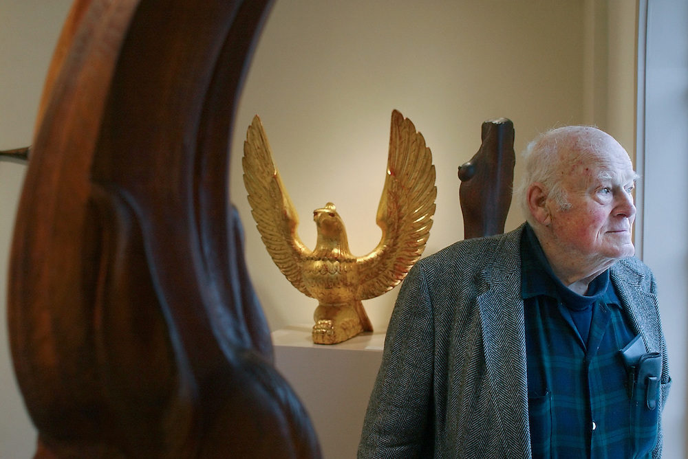 Gloucester: James McClellan, of Ipswich, stands among some of his sculptures at the Cape Ann Historical Museum Wednesday. McClellan has his work on exhibit at the museum through January 31, 2003. (Photo by Mike Dean/Gloucester Daily Times).