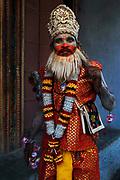 A boy is dressed as the Hindu god Hanuman, the Monkey God, to raise funds during the November Pushkar Fair.