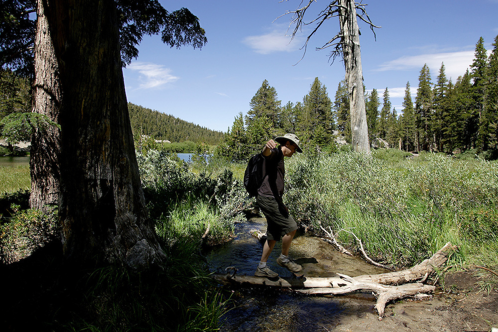 MAMMOTH, CA, AUG 22, 2006:  A man crosses part of Coldwater Canyon Creek at Emerald Lake in Mammoth, California  on August 22, 2006  (Photograph by Todd Bigelow/Aurora).