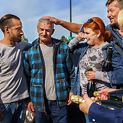 Harvest workers say goodbye at Champagne Mumm.