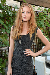 CLARA PAGET attending the Warner Bros. & Esquire Summer Party held at Shoreditch House, Ebor Street, London E1 on 18th July 2013.