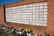 Memorial plaques wall of remembrance Woodbridge cemetery, Suffolk, England