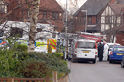 (c) Licensed to London News Pictures 12/12/2011. A murder investigation has started after the discovery of the bodies of two adults and two children at a house in Leeds. The bodies were found in a fire-damaged bedroom, upstairs at a detached house on Sheridan Way, Pudsey, police said.Policewoman in Sheridan Way, Pudsey, Leeds.Photo credit : Sam Atkins/LNP