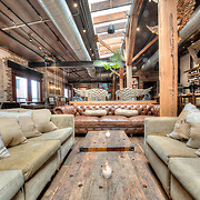The upstairs lounge bar in Virtue Feed and Grain, a restaurant and tavern in Old Town Alexandria, Virginia. The restaurant is located in a renovated historic building that once served as a feed and grain warehouse.