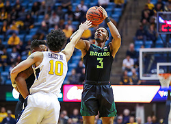 Jan 21, 2019; Morgantown, WV, USA; Baylor Bears guard King McClure (3) shoots a three pointer during the first half against the West Virginia Mountaineers at WVU Coliseum. Mandatory Credit: Ben Queen-USA TODAY Sports