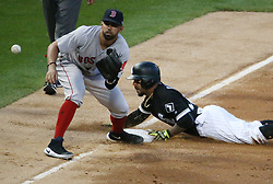 May 31, 2017 - Chicago, IL, USA - The Chicago White Sox's Leury Garcia goes to third base on a wild pitch by Boston Red Sox pitcher Drew Pomeranz during the third inning at Guaranteed Rate Field in Chicago on Wednesday, May 31, 2017, as Boston third baseman Deven Marrero, left, takes the throw. (Credit Image: © Nuccio Dinuzzo/TNS via ZUMA Wire)
