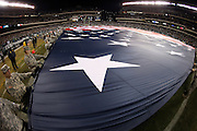 Members of the United States Army hold a large American flag on the field during pregame celebrations before the Philadelphia Eagles NFL NFC Wild Card football game against the New Orleans Saints on Saturday, Jan. 4, 2014 in Philadelphia. The Saints won the game 26-24. ©Paul Anthony Spinelli