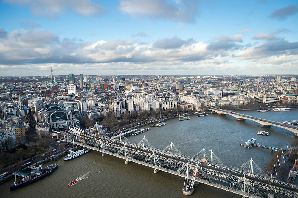 High angle view of the Hungerford Bridge and the Golden Jubilee Bridges and the skyline of north London from the London Eye, London, England.