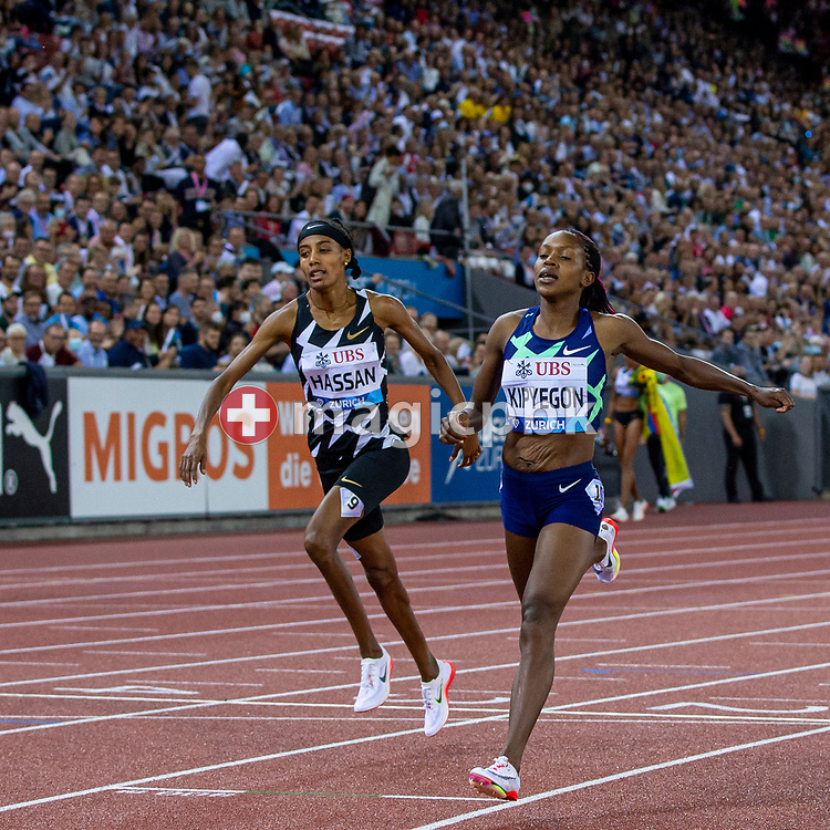 Faith Kipyegon, right, of Kenya crosses the finish line to win the 1500m Women next to Sifan Hassan, left, of the Netherlands during the Iaaf Diamond League meeting (Weltklasse Zuerich) at the Letzigrund Stadium in Zurich, Switzerland, Thursday, Sept. 9, 2021. (Photo by Patrick B. Kraemer / MAGICPBK)