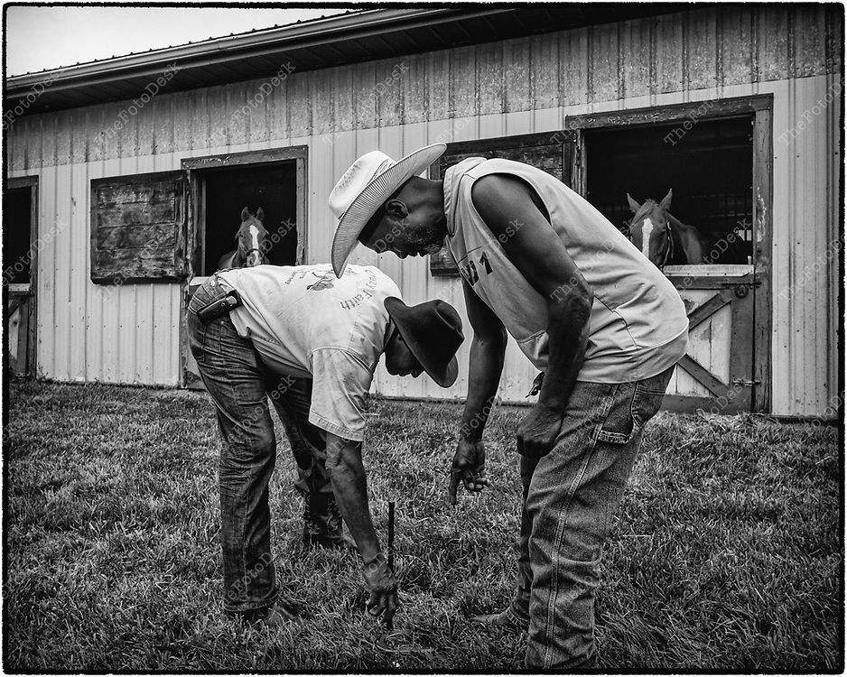 FLEMINGTON, NEW JERSY: Country and C play a game of horse shoes during a cowboy celebration in Flemington, NJ on Saturday, August 28, 2021.  The celebration featured team sorting, horseback riding and a cookout.    (Brian Branch-Price/TheFotoDesk)