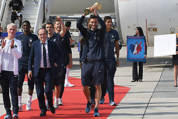 France's head coach Didier Deschamps, French Football federation president Noel Le Graet and goalkeeper Hugo Lloris, rising the trophy, disembark from the plane with teammates upon their arrival at the Roissy-Charles de Gaulle airport on the outskirts of Paris, France, on July 16, 2018 after winning the Russia 2018 World Cup final football match. Photo by ABACAPRESS.COM