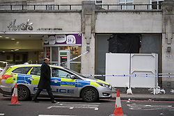 © Licensed to London News Pictures. 03/01/2019. London, UK. A police car parked outside the entrance doorway to 80 Park Lane in Mayfair, where security guard Tudor Simionov was stabbed to death in the early hours of New Year's day. The 33-year-old and his colleagues were attacked by a group of men who were trying to gain entry to a party at Fountain House, a £12.5 million townhouse in London's West End.. Photo credit: Ben Cawthra/LNP