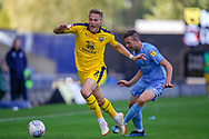Oxford United defender Cameron Norman (2) fouled by Coventry City midfielder Jordan Shipley (26) during the EFL Sky Bet League 1 match between Oxford United and Coventry City at the Kassam Stadium, Oxford, England on 9 September 2018.