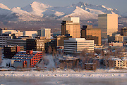 Alaska. Anchorage Aerials in winter with icy Cook Inlet and snowy Chugach Mountains.