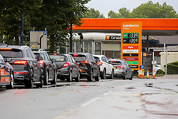 © Licensed to London News Pictures. 27/09/2021. London, UK. Motorists queue for the fourth day of the fuel crisis at Sainsbury's petrol station in north London, amid fears of fuel running out due to a shortage of HGV drivers. Photo credit: Dinendra Haria/LNP