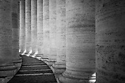 Columns at the St Peter's Basilica in Rome, Italy. The Papal Basilica of Saint Peter, officially known in Italian as the Basilica Papale di San Pietro in Vaticano and commonly known as St. Peter's Basilica, is a Late Renaissance church located within the Vatican City.