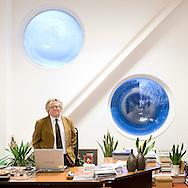 Nederland, Roermond, 20081204..Jan van der Varst.staande in zijn werkruimte.  voorzitter Centrale Directie Scholengroep Roermond..locatie Niekée..