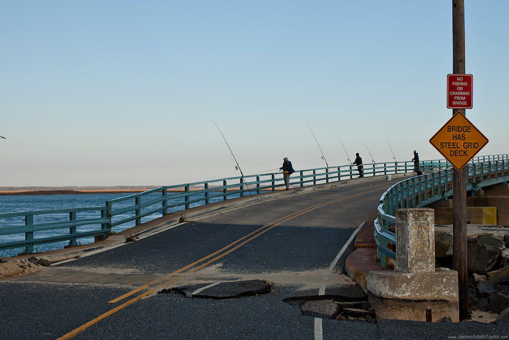 The Bridge over Townsends Inlet may be closed to traffic, but the fisherman are there despite the sign , Ocean Drive, Avalon New Jersey.