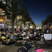 """Protesters gather outside of the Amway Arena, home of the Orlando Magic, to perform a """"die in"""" to rally against police brutality on Wednesday, December 10, 2014 in Orlando, Florida.  Since a Staten Island grand jury decided last week not to bring any charges against a white officer who was seen on video using a chokehold on Eric Garner, and other use of questionable force issues by the police across the country, the Orlando protesters wanted to represent the city of Orlando. (AP Photo/Alex Menendez)"""