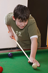 Boy playing pool in Youth Club. Cleared for Mental Health Issues.