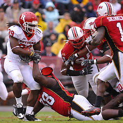 Sep 26, 2009; College Park, MD, USA; Rutgers running back Jourdan Brooks (39) breaks a tackle attempt by Maryland defensive lineman Chris Rhodes (98) during the first half of Rutgers' 34-13 victory over Maryland in NCAA college football at Byrd Stadium.