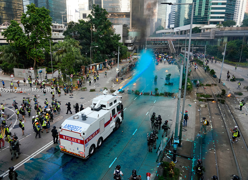 Hong Kong. 1 October 2019. After a peaceful march through Hong Kong Island by an estimated 100,000 pro democracy supporters, violent flared up at Tamar, Admiralty and moved through Wanchai district. Police used teargas and baton rounds and water cannon. Hard core group lit fires, threw bricks and Molotov cocktails at police. Violence continues into evening. Water cannon used on protestors.  Iain Masterton/Alamy Live News.