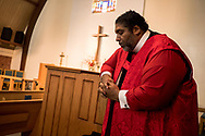 Rev. Dr. William J. Barber, II, takes a moment to himself as a crowd sings during the first 'Moral Monday at The Borderlands' interfaith protest against the Trump administration's immigration policies at the All Saints Episcopal Church in El Paso, Texas, July 29, 2019.