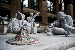 August 4, 2017 - London, England, United Kingdom - 'Plasticide' installation by Jason deCaires Taylor is seen on the Southbank at London Bridge, London on August 4, 2017. British sculptor Jason deCaires Taylor wanted to draw our attention to marine pollution with his provocative art installation. On London's Southbank Jason placed a dystopian vision of a family picnic on a beach plagued by plastic pollution. Part of his artwork is constructed with microplastics, which were collected along the shores of Lanzarote. The installation should request consumers, policymaker and packaging producers to cut back on the use of plastics. (Credit Image: © Alberto Pezzali/NurPhoto via ZUMA Press)