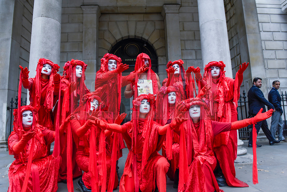 © Licensed to London News Pictures. 16/09/2019. LONDON, UK.  Members of the Invisible Circus, commonly associated with climate change group Extinction Rebellion, outside the Scottish Office in Whitehall joining anti-Brexit protesters, the day before the Supreme Court is to begin a three-day hearing to decide whether or not the decision of Prime Minister Boris Johnson to prorogue Parliament is unlawful.  Photo credit: Stephen Chung/LNP