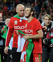 Gareth Bale of Wales celebrates with James Collins as they qualify for Euro 2016 - Mandatory byline: Dougie Allward/JMP - 07966 386802 - 13/10/2015 - FOOTBALL - Cardiff City Stadium - Cardiff, Wales - Wales v Andorra - European Qualifier 2016 - Group B