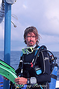 environmental activist Paul Foley prepares to make a dive on Monad Shoals to observe the pelagic thresher sharks that he is  attempting to protect, Philippines
