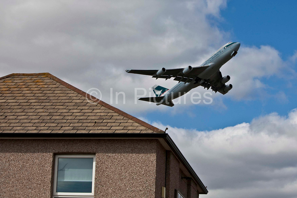 A plane taking off from London's Heathrow Airport and flying over the Hatton Cross area of Hounslow Borough.
