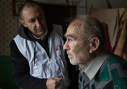 Doctor Kachatur Malakyan and nurse Andrei Bogma of MSF visit the home of Pavlo Virienko, 86, and his wife Lydia, 86, as part of a follow up visit in the home visits project. Pavlo is alone in caring for his frail elderly wife and is scared to venture far from their home due to the recent fighting in the town. He recently fell and cut his face whilst trying to bring home food from a himanitarina food distribution. One of their daughters is able to visit once a week but their other daughter lives on the other side of the frontline in Ukraine and is blocked from visiting her parents due to the security restrictions.