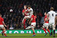 Rhys Patchell of Wales and Anthony Watson of England jump for a high ball. England v Wales, NatWest 6 nations 2018 championship match at Twickenham Stadium in Middlesex, England on Saturday 10th February 2018.<br /> pic by Andrew Orchard, Andrew Orchard sports photography