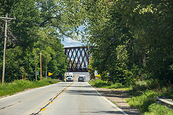 UP IL29 Bridge<br /> <br /> Overview<br /> Quadrangular Through truss bridge over IL 29 on Union Pacific Railroad<br /> Location<br /> Tazewell County, Illinois<br /> Status<br /> Open to traffic<br /> History<br /> Built 1913<br /> Railroads<br /> - Chicago & North Western Railway (CNW)<br /> - Union Pacific Railroad (UP)<br /> Design<br /> Quadrangular lattice through truss<br /> Dimensions<br /> Total length: 167.0 ft.