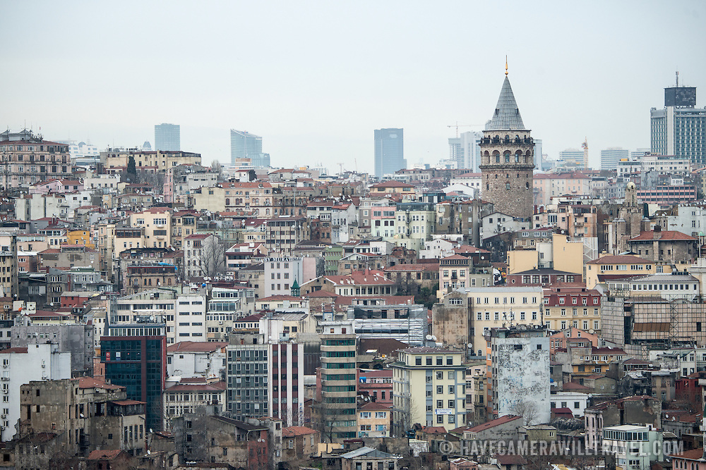 The buildings and skyline of the Galata/Karakoy district in Istanbul, Turkey, with Galata Tower standing tall to the right.
