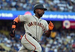 March 29, 2018 - Los Angeles, CA, U.S. - LOS ANGELES, CA - MARCH 29: San Francisco Giants Right field Andrew McCutchen (22) runs towards first during the MLB opening day game between the San Francisco Giants and the Los Angeles Dodgers on March 29, 2018 at Dodger Stadium in Los Angeles, CA. (Photo by Chris Williams/Icon Sportswire) (Credit Image: © Chris Williams/Icon SMI via ZUMA Press)