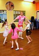 Paige Lark leads a dance class at The Little Gym in Brentwood on Saturday, May 19, 2012.  (Photo by Kevin Bartram)