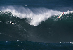 December 13, 2017 - Waimea Bay, HI, USA - WAIMEA BAY, HI - DECEMBER 13, 2017 - Surfers abandon their surfboards as a large wave rolls through Waimea Bay. 18-22 ft waves broke at Waimea Bay Wednesday. The big wave surfing spot only breaks in the winter when storms send large north swells toward the North Shore of Oahu. (Credit Image: © Erich Schlegel via ZUMA Wire)