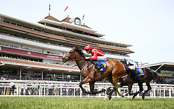 Ice Age (left) ridden by Charles Bishop wins the Starlight Brightening Lives Handicap Stakes at Newbury Racecourse.