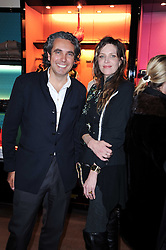 Shanghai Tang Executive Chairman, Raphael le Masne de Chermont and MARTHA FIENNES at a private view of her work entitled 'Martha Fiennes' held at Shanghai Tang, Sloane Street, London on 9th February 2010.