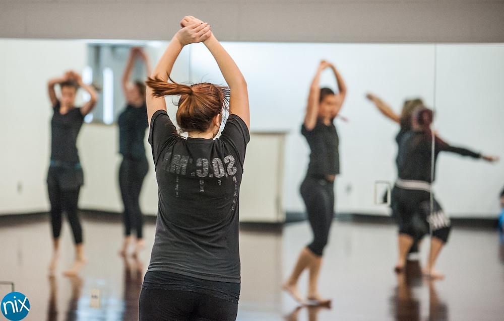 Cox Mill dance teacher Liz Crawford's class runs through exercises Friday afternoon.