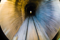 Train tracks leaving a tunnel, The Chihuahua al Pacifico Railroad between El Fuerte and the Copper Canyon, Mexico
