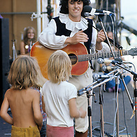 """Donovan - and the Pee Wee Three.-.Donovan amused the audience with a rendition of """"How much of a Pee do you Wee when you're little and only three?"""" he was joined on stage by three small blond boys. Some people joked that they could have been girls, and this apparently greatly amused another artist, Joan Baez who was back stage at the time."""