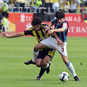 Trabzonspor's Hrvoje CALE (R) and Fenerbahce's Mehmet TOPUZ (L) during their Turkey Cup final match Trabzonspor between Fenerbahce at the GAP Arena Stadium at Urfa Turkey on wednesday, 05 May 2010. Photo by TURKPIX