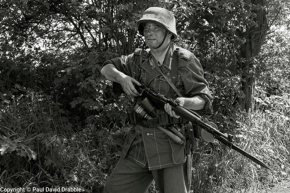 Reenactor portraying a member of 1 Kompanie Gro§deutschland on gate duty at Fort Paull<br /> <br />   04May 2015<br />   Image © Paul David Drabble <br />   www.pauldaviddrabble.co.uk