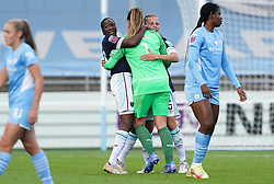 West Ham United goalkeeper Mackenzie Arnold (centre right) celebrates with teammates after the final whistle at the FA Women's Super League match at Academy Stadium, Manchester. Picture date: Sunday October 3, 2021.