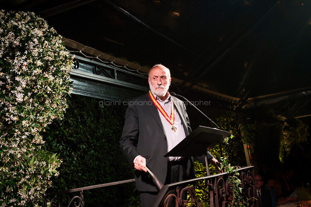 ROME, ITALY - 3 JUNE 2015: President of Slow Food Carlo Petrini gives a speech after receiving McKim Medal Award at the Gala honouring him and Paolo Sorrentino at the American Academy  in Rome, Italy, on June 3rd 2015.